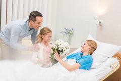 happy father and daughter bringing flowers to stock photography