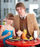 Happy father and daughter in cafe. Royalty Free Stock Image