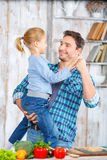 Happy father and daughter cooking together Stock Photos