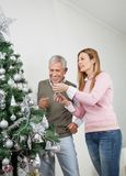 Happy Father And Daughter Decorating Christmas Royalty Free Stock Images