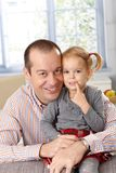 Happy father and daughter at home smiling Royalty Free Stock Image