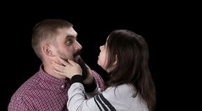Happy father and daughter hugging on black background stock images