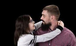 Happy father and daughter hugging on black background stock photos