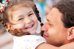 Happy father and daughter hugging Stock Photo