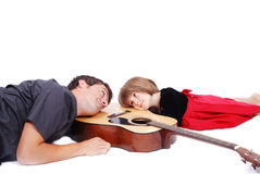Happy father and daughter lie on guitar. Happy father is huging his daughter isolated Royalty Free Stock Photos