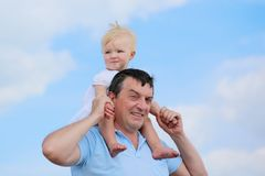 Happy father and daughter outdoors against blue sky Stock Image