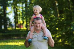 Happy father and daughter outdoors in the park Stock Photography
