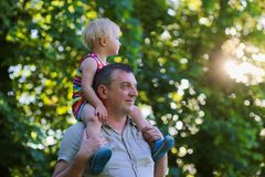 Happy father and daughter outdoors in the park Royalty Free Stock Photography
