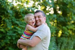 Happy father and daughter outdoors in the park Stock Images