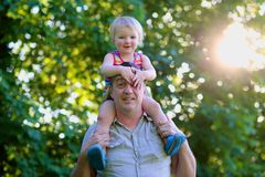 Happy father and daughter outdoors in the park Royalty Free Stock Photos