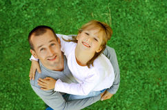 Happy father and daughter in a park. A top view Stock Photos