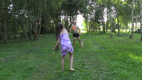 Happy father with daughter play badminton game stock video