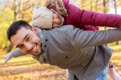Happy father and daughter playing at autumn park stock image