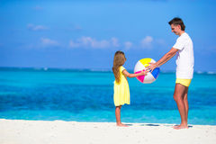 Happy father and daughter playing with ball having Royalty Free Stock Image