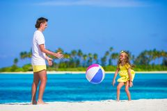 Happy father and daughter playing with ball having Stock Image