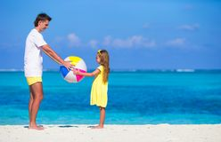 Happy father and daughter playing with ball having Stock Photo