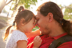 Happy father and daughter playing and laughing. Royalty Free Stock Photos