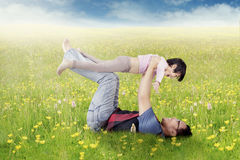 Happy father and daughter playing on meadow Royalty Free Stock Image