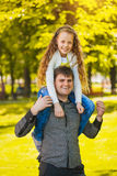 Happy father and daughter are playing in the park Stock Photography