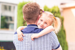 Happy father and daughter playing in the park Royalty Free Stock Photos