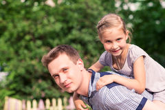 Happy father and daughter playing in the park Royalty Free Stock Image
