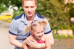 Happy father and daughter playing in the park Royalty Free Stock Photography