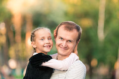 Happy father and daughter playing in the park Stock Image