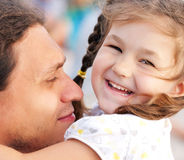 Happy father and daughter playing together Stock Image