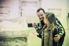 Happy father and daughter regarding classical bas-reliefs in mus. Happy father and teen daughter regarding classical bas-reliefs in museum Royalty Free Stock Images