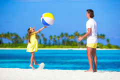 Happy father and daughter running on the beach Royalty Free Stock Photo