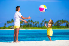 Happy father and daughter running on the beach Stock Photography