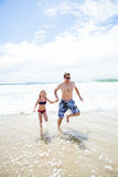 Happy father and daughter running at beach Royalty Free Stock Image