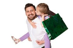 Happy father and daughter with shopping bags Stock Photos