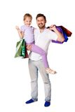 Happy father and daughter with shopping bags Stock Photo