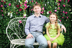 Happy father and daughter sit on white retro bench Royalty Free Stock Images