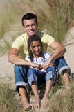 Happy Father and Daughter Sitting At Beach Stock Image