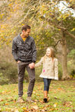 Happy father and daughter walking together in park Royalty Free Stock Photography