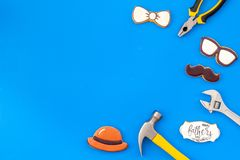 Happy Father Day with bow tie, moustache, glasses and hat cookies and instruments on blue background top view mockup. Happy Father Day celebration with cookies royalty free stock photos