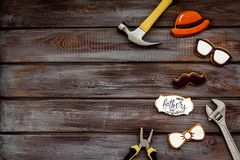 Happy Father Day with bow tie, moustache, glasses and hat cookies and instruments on wooden background top view mockup. Happy Father Day celebration with cookies royalty free stock photography
