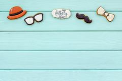 Happy Father Day with bow tie, moustache, glasses and hat cookies on mint green wooden background top view mockup. Happy Father Day celebration with cookies in royalty free stock photo