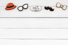 Happy Father Day with bow tie, moustache, glasses and hat cookies on white background top view mockup. Happy Father Day celebration with cookies in shape of bow royalty free stock photo