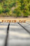 Happy father day concept. Word of wooden father day on wood on green tree background idea Royalty Free Stock Images