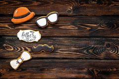 Happy Father Day with copy, bow tie, moustache, glasses and hat cookies on wooden background top view mockup. Happy Father Day celebration with cookies in shape royalty free stock photos