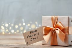 Happy Father Day greeting card . Holiday present concept. Happy Father Day greeting card with tag on wooden background. Holiday present concept royalty free stock image