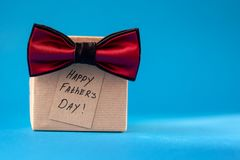 Happy Father Day greeting card with tag on blue background. Holiday present concept.  stock image