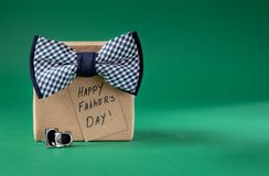 Happy Father Day greeting card with tag on green background. Holiday present concept stock photography