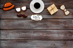Happy Father Day with hat, glasses, moustache cookies, gift and coffee on wooden background top view mockup. Happy Father Day celebration with hat, glasses royalty free stock photo