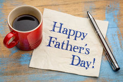 Happy father day on napkin. Happy father`s day - handwriting on a napkin  with a cup of coffee Royalty Free Stock Photo