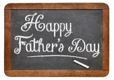 Happy father day. Happy father's day in white chalk on a vintage slate blackboard Royalty Free Stock Photography