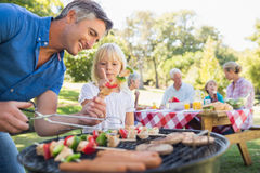 Happy father doing barbecue with her daughter Stock Image